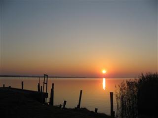日の出と光